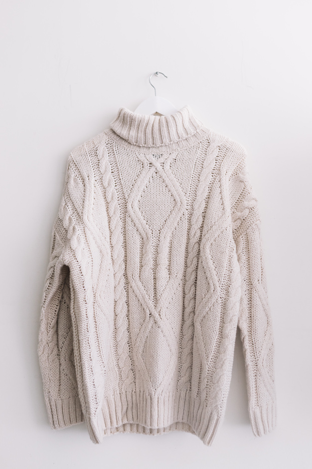 sweater-on-clothes-hunger_23-2147955955